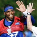 Carolina Panthers quarterback Cam Newton high-fives with a member of the staff while taking the field during the NFL football team's training camp in Spartanburg, S.C., Thursday, July 28, 2016. (AP Photo/Gerry Broome)