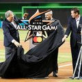Jeffrey Loria, left, owner of the Miami Marlins, Robert Manfred Jr., commissioner of baseball, and Jeff Conine, special assistant to the president of the Marlins, unveil the official logo for the 2017 All-Star Game that will be held in Miami, during a ceremony before the start of a baseball game between the Miami Marlins and the Philadelphia Phillies, Wednesday, July 27, 2016, in Miami. (AP Photo/Wilfredo Lee)