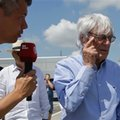 Formula One boss Bernie Ecclestone gesticulates as he answers to a reporter upon his arrival at the Hungaroring racetrack, in Budapest, Hungary, Friday, July 22, 2016. The Hungarian Formula One Grand Prix will be held on Sunday July, 24. (AP Photo/Luca Bruno)