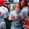 Teammates greet St. Louis Cardinals Jedd Gyorko, center, after he hit a third-inning, two-run, home run during the first game of a baseball doubleheader against the New York Mets, Tuesday, July 26, 2016, in New York. (AP Photo/Kathy Willens)