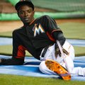 Miami Marlins second baseman Dee Gordon stretches out before the start of a baseball game against the St. Louis Cardinals, Thursday, July 28, 2016, in Miami. Gordon issued an apology on Twitter addressed primarily to his young fans as he returned from an 80-game suspension for a positive drug test. (AP Photo/Wilfredo Lee)