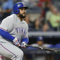 FILE - In this Tuesday, June 28, 2016 file photo Texas Rangers' Prince Fielder watches his eighth-inning RBI double during a baseball game against the New York Yankees in New York. Texas Rangers slugger Prince Fielder is facing the prospect of season-ending neck surgery after an MRI revealed a herniated disk just above an area that was repaired two years ago, Wednesday, July 20, 2016. (AP Photo/Kathy Willens, File)