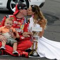 Kyle Busch kisses his wife Samantha as he holds their son Brexton after wining the Brickyard 400 NASCAR auto race at Indianapolis Motor Speedway in Indianapolis, Sunday, July 24, 2016. (AP Photo/Rob Baker)