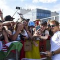 Mercedes driver Nico Rosberg of Sweden signs autographs at the Hungaroring racetrack, in Budapest, Hungary, Thursday, July 21, 2016. The Hungarian Formula One Grand Prix will be held on Sunday July, 24. (Janos Marjai/MTI via AP)
