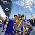 Minnesota Vikings fans Larry Spooner, left, of Plymouth, and Syd Davy, of Vancouver, British Columbia, pose for a photo at the ceremonial grand opening ribbon-cutting for U.S. Bank Stadium in Minneapolis, Friday, July 22, 2016. (Leila Navidi/Star Tribune via AP)