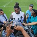 Miami Dolphins' Jordan Phillips (97) talks to the media after the NFL football teams training camp in Davie, Fla., Friday, July 29, 2016. (AP Photo/Joel Auerbach)