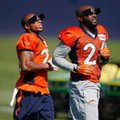 Denver Broncos free safety Darian Stewart, right, and cornerback Chris Harris wear blinders as they take part in drills during the team's opening session of NFL football training camp Thursday, July 28, 2016, in Englewood, Colo. (AP Photo/David Zalubowski)