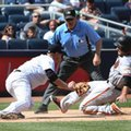 New York Yankees third baseman Chase Headley, left, completes a double play by tagging out San Francisco Giants' Mac Williamson at third base during the eighth inning of the baseball game at Yankee Stadium, Sunday, July 24, 2016 in New York. (AP Photo/Seth Wenig)