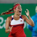 FILE- In this Aug. 13, 2016, file photo, Monica Puig, of Puerto Rico reacts after winning the final point of the gold medal match in the women's tennis competition at the 2016 Summer Olympics in Rio de Janeiro, Brazil. A few weeks ago, Puig was a player outside the top 30 with one career title who had never made it past the fourth round at a major. Now she comes into the U.S. Open as an Olympic gold medalist. (AP Photo/Vadim Ghirda, File)
