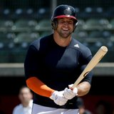 Determined to chase dream, Tebow shows power in MLB workout
