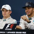 FILE - In this Sunday, Sept. 27, 2015, fie photo, Mercedes driver Lewis Hamilton, right, of Britain speaks next to teammate Nico Rosberg of Germany during a press conference after winning the Japanese Formula One Grand Prix at the Suzuka Circuit in Suzuka, central Japan. Rosberg would have spent much of the summer break agonizing over how a 43-point lead over Lewis Hamilton in the Formula One championship had turned into a deficit of 19. (AP Photo/Shizuo Kambayashi, file)