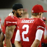 Kaepernick's decision to sit through anthem scrutinized