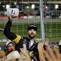 FILE - In this June 11, 2016, file photo, James Hinchcliffe prepares to toss out a signed cap to fans in the stands as he and other drivers greeted people and signed autographs during a rain delay at the IndyCar auto race at Texas Motor Speedway in Fort Worth, Texas. When the rain-interrupted race finally resumes on lap 72 Saturday night, Hinchcliffe will have been leading for 76 days. (AP Photo/Tony Gutierrez, File)