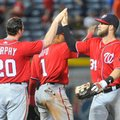 Washington Nationals' Daniel Murphy (20) and Bryce Harper (34) celebrate after the ninth inning of baseball game against the Atlanta Braves, Saturday, Aug. 20, 2016, in Atlanta. Washington won 11-9. (AP Photo/John Amis)