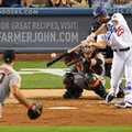 Los Angeles Dodgers' Rob Segedin, right, hits a solo home run off San Francisco Giants starting pitcher Madison Bumgarner, left, as catcher Buster Posey watches during the second inning of a baseball game, Tuesday, Aug. 23, 2016, in Los Angeles. (AP Photo/Mark J. Terrill)