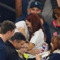 Heather Terwilliger and Andrew Fox embrace after the couple became engaged during a baseball game between the New York Yankees and the Boston Red Sox in New York, Tuesday, Sept. 27, 2016. Fox's first attempt went awry when he opened the box and the engagement ring was missing. Eventually the ring was located in the cuff of Terwilliger's pants. The second time was the charm. (AP Photo/Kathy Willens)