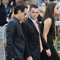 Miami Marlins president David Samson, center, and musician Marc Anthony, left, arrive for a memorial service for Miami Marlins pitcher Jose Fernandez at St. Brendan's Catholic Church, Thursday, Sept. 29, 2016, in Miami. Fernandez was killed in a boating accident Sunday along with two friends. (AP Photo/Lynne Sladky)