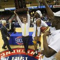 FILE - In this March 7, 2016, file photo, Chattanooga head coach Matt McCall celebrates with his team after winning the Southern Conference men's basketball championship in an NCAA college basketball game against East Tennessee State University in Asheville, N.C. The Southern Conference will keep four league championships in North Carolina despite the NCAA and the ACC withdrawing championships because of the state law restricting rights of LGBT people. The championships are: men's soccer in Greensboro, men's and women's basketball in Asheville and men's golf in Pinehurst.