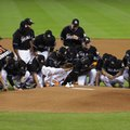 Miami Marlins players wearing a jersey in honor of pitcher Jose Fernandez (16) gather around the pitching mound before a baseball game against the New York Mets, Monday, Sept. 26, 2016, in Miami. Fernandez died in a boating accident Sunday. (AP Photo/Lynne Sladky)