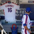 A jersey with Miami Marlins Jose Fernandez name and number hangs in the New York Mets dugout before the baseball game against the Philadelphia Phillies at Citi Field, Sunday, Sept. 25, 2016 in New York. (AP Photo/Seth Wenig)