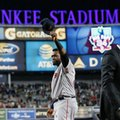 Boston Red Sox designated hitter David Ortiz waves his cap to the crowd as retired New York Yankees pitcher Mariano Rivera walks away, right, after Ortiz was honored before a baseball game between the Yankees and the Red Sox in New York, Thursday, Sept. 29, 2016. (AP Photo/Kathy Willens)
