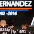 Colorado Rockies including Darin Everson, left, observe a moment of silence for Miami Marlins' pitcher Jose Fernandez prior to a baseball game against the San Francisco Giants, Tuesday, Sept. 27, 2016, in San Francisco. Fernandez was killed in a boating accident on Sunday, Sept. 25, 2016. (AP Photo/Ben Margot)