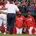 Washington Nationals manager Dusty Baker (12), center, watches as Washington Nationals catcher Wilson Ramos (40), second from left, is helped off the field after injuring his knee during the 6th inning of a baseball game at Nationals Park in Washington, Monday, Sept. 26, 2016. (AP Photo/Andrew Harnik)