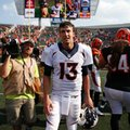Denver Broncos quarterback Trevor Siemian (13) walks the field after an NFL football game against the Cincinnati Bengals, Sunday, Sept. 25, 2016, in Cincinnati. The Broncos won 29-17. (AP Photo/Gary Landers)