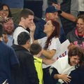 Fans laugh as Andrew Fox and Heather Terwilliger smile during a baseball game between the New York Yankees and the Boston Red Sox at Yankee Stadium in New York, Tuesday, Sept. 27, 2016. As Fox knelt to propose to Terwilliger, he pulled an engagement ring from his pocket - and it fell to the ground. The ring was found after a few minutes. (AP Photo/Kathy Willens)