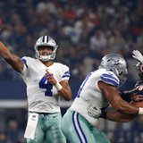 The Latest: Cowboys roll with Prescott, lead Bears at half