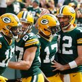 Green Bay Packers' Aaron Rodgers (12) congratulates wide receiver Davante Adams (17) after his touchdown catch during the first half of an NFL football game against the Detroit Lions Sunday, Sept. 25, 2016, in Green Bay, Wis. (AP Photo/Mike Roemer)