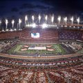 Flags are displayed and fireworks are set off during the national anthem before an NCAA college football game between Tennessee and Virginia Tech at Bristol Motor Speedway on Saturday, Sept. 10, 2016, in Bristol, Tenn.