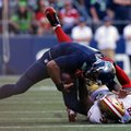 Seattle Seahawks quarterback Russell Wilson, top, is pulled down by San Francisco 49ers' Eli Harold in the second half of an NFL football game, Sunday, Sept. 25, 2016, in Seattle. (AP Photo/Ted S. Warren)