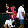 Britain's Andy Murray, left, walks on the court as Argentina's Juan Martin del Potro walks off during training session at the Emirates Arena, Glasgow Scotland Thursday Sept.15, 2016. Britain play against Argentina a Davis Cup semifinal match starting Friday. (Andrew Milligan/PA via AP)