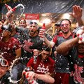 Washington Nationals' Bryce Harper, center left, and Max Scherzer, center right, celebrate with teammates after clinching the National League East following a 6-1 win over the Pittsburgh Pirates in a baseball game in Pittsburgh, Saturday, Sept. 24, 2016. (AP Photo/Gene J. Puskar)