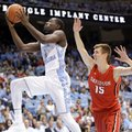 FILE - In this Dec. 6, 2015, file photo, North Carolina's Theo Pinson (1) drives to the basket as Davidson's Oskar Michelsen (15) defends during the first half of an NCAA college basketball game in Chapel Hill, N.C. The school said Friday, Oct. 21, 2016, that Pinson is out indefinitely with a broken right foot. UNC opens the season at Tulane on Nov. 11.