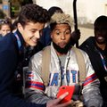 New York Giants wide receiver Odell Beckham Jr. poses for a picture as he sits on a golf buggy before being driven away after a press conference at Syon House in Syon Park, south west London, Friday, Oct. 21, 2016. The Los Angeles Rams are due to play the New York Giants at Twickenham stadium in London on Sunday in a regular season NFL game. (AP Photo/Matt Dunham)