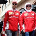 FILE - In this May 29, 2016, file photo, Ferrari drivers Sebastian Vettel, left, of Germany, and Kimi Raikkonen, of Finland, walk to the driver's parade prior to the start of the Monaco Formula One Grand Prix auto race in Monaco. Ferrari expected much better than this in 2016. After ending last season with three wins and promises of pulling closer to Mercedes this year, Ferrari instead slid backward. There have been no victories, just one podium in the last nine races and Ferrari is once again fending off questions about discord within motorsport's most popular team heading into this week's Mexican Grand Prix (AP Photo/Petr David Josek, File)
