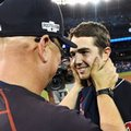 Cleveland Indians manager Terry Francona, left, congratulate starting pitcher Ryan Merritt after the Indians defeated the Toronto Blue Jays 3-0 during Game 5 of the baseball American League Championship Series, in Toronto on Wednesday, Oct. 19, 2016. (Frank Gunn/The Canadian Press via AP)
