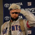 New York Giants wide receiver Odell Beckham Jr. shields his eyes from a spotlight during a press conference at Syon House in Syon Park, south west London, Friday, Oct. 21, 2016. The Los Angeles Rams are due to play the New York Giants at Twickenham stadium in London on Sunday in a regular season NFL game. (AP Photo/Matt Dunham)