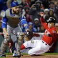 Toronto Blue Jays catcher Russell Martin (55) can't handle the throw as Boston Red Sox's Brock Holt slides into home to score during the first inning of a baseball game at Fenway Park, Friday, Sept. 30, 2016, in Boston. (AP Photo/Elise Amendola)