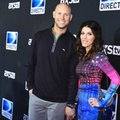 FILE - In this Saturday, Jan. 31, 2015, file photo, Josh Brown, left, and Molly Brown arrive at the 2015 DIRECTV Super Saturday Night at the Pendergast Family Farm, in Glendale, Ariz. Coach Ben McAdoo said Friday, Oct. 21, 2016, that the New York Giants have not yet decided whether Josh Brown will remain on the team after admitting to abuse of his former wife. McAdoo faced repeated questioning about the kicker following the Giants' first practice in London for a game Sunday against the Los Angeles Rams. (Photo by Scott Roth/Invision/AP, File)