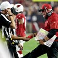 Arizona Cardinals head coach Bruce Arians hands the referees the red flag during the first half of a football game against the Seattle Seahawks, Sunday, Oct. 23, 2016, in Glendale, Ariz. (AP Photo/Rick Scuteri)
