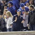 A Chicago-area man sits in the same seat that Steve Bartman had for Game 6 of the NL Championship Series on Saturday, Oct. 22, 2016, in Chicago. Providing only his first name and very few details, Bryan said he knew ahead of time he was sitting in the same spot Bartman made famous during Game 6 of the 2003 NLCS, and he was just excited to root on the Cubs as they tried for their first pennant since 1945. (AP Photo/Charles Rex Arbogast)