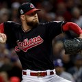 Cleveland Indians starting pitcher Corey Kluber throws against the Chicago Cubs during the first inning of Game 1 of the Major League Baseball World Series Tuesday, Oct. 25, 2016, in Cleveland. (AP Photo/Matt Slocum)