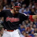 Cleveland Indians relief pitcher Andrew Miller celebrates after the end of the top of the seventh inning against the Chicago Cubs during Game 1 of the Major League Baseball World Series Tuesday, Oct. 25, 2016, in Cleveland. (AP Photo/Matt Slocum)