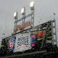 Rain drops roll down a window at Progressive Field before Game 2 of the Major League Baseball World Series between the Cleveland Indians and the Chicago Cubs Wednesday, Oct. 26, 2016, in Cleveland. (AP Photo/Charlie Riedel)