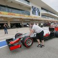 The crew for Haas driver Romain Grosjean, of France, pushes his car down pit lane at the Formula One U.S. Grand Prix auto race at the Circuit of the Americas, Thursday, Oct. 20, 2016, in Austin, Texas. (AP Photo/Tony Gutierrez)