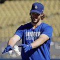 Los Angeles Dodgers' Clayton Kershaw throws some balls in a basket before Game 5 of the National League baseball championship series against the Chicago Cubs Thursday, Oct. 20, 2016, in Los Angeles. (AP Photo/David J. Phillip)