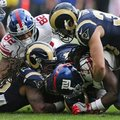 Los Angeles Rams and New York Giants players battle for the ball during an NFL football game at Twickenham stadium in London, Sunday Oct. 23, 2016. (AP Photo/Tim Ireland)